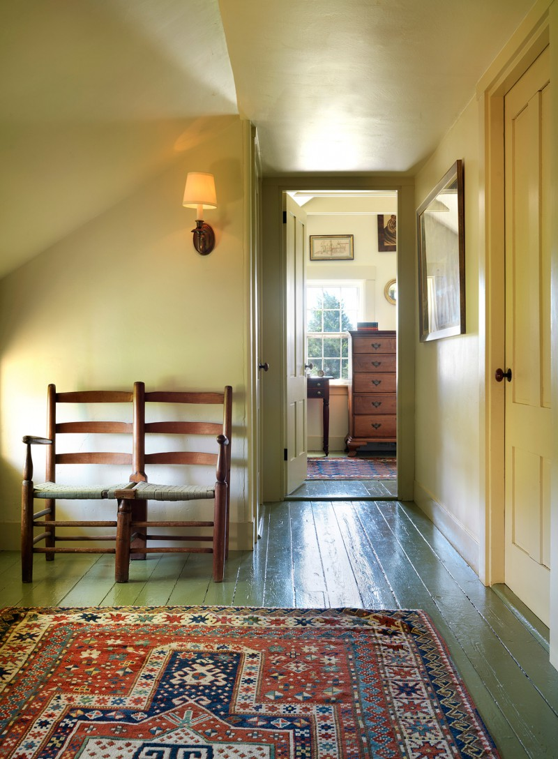sunny hallway leading to bedroom Original plank floors