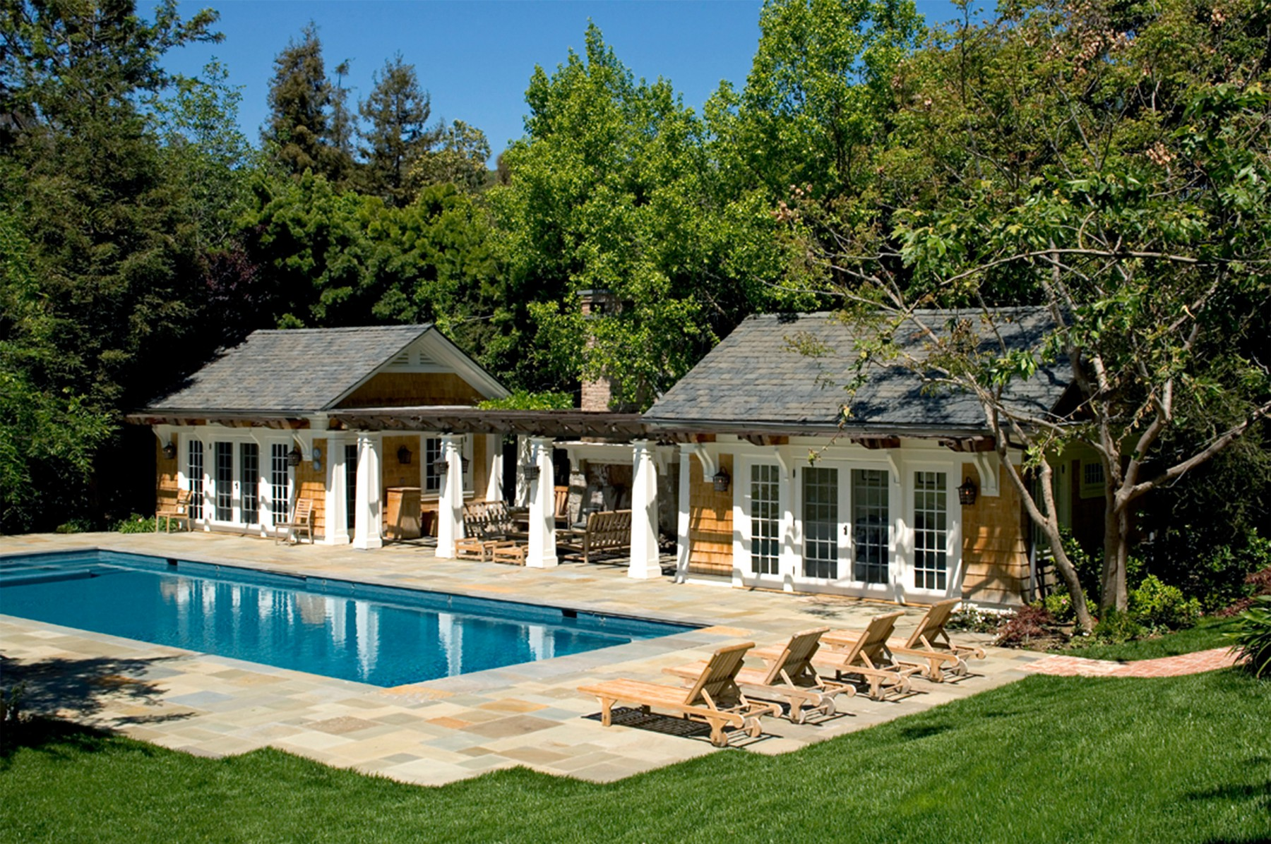 private pool house stone patio