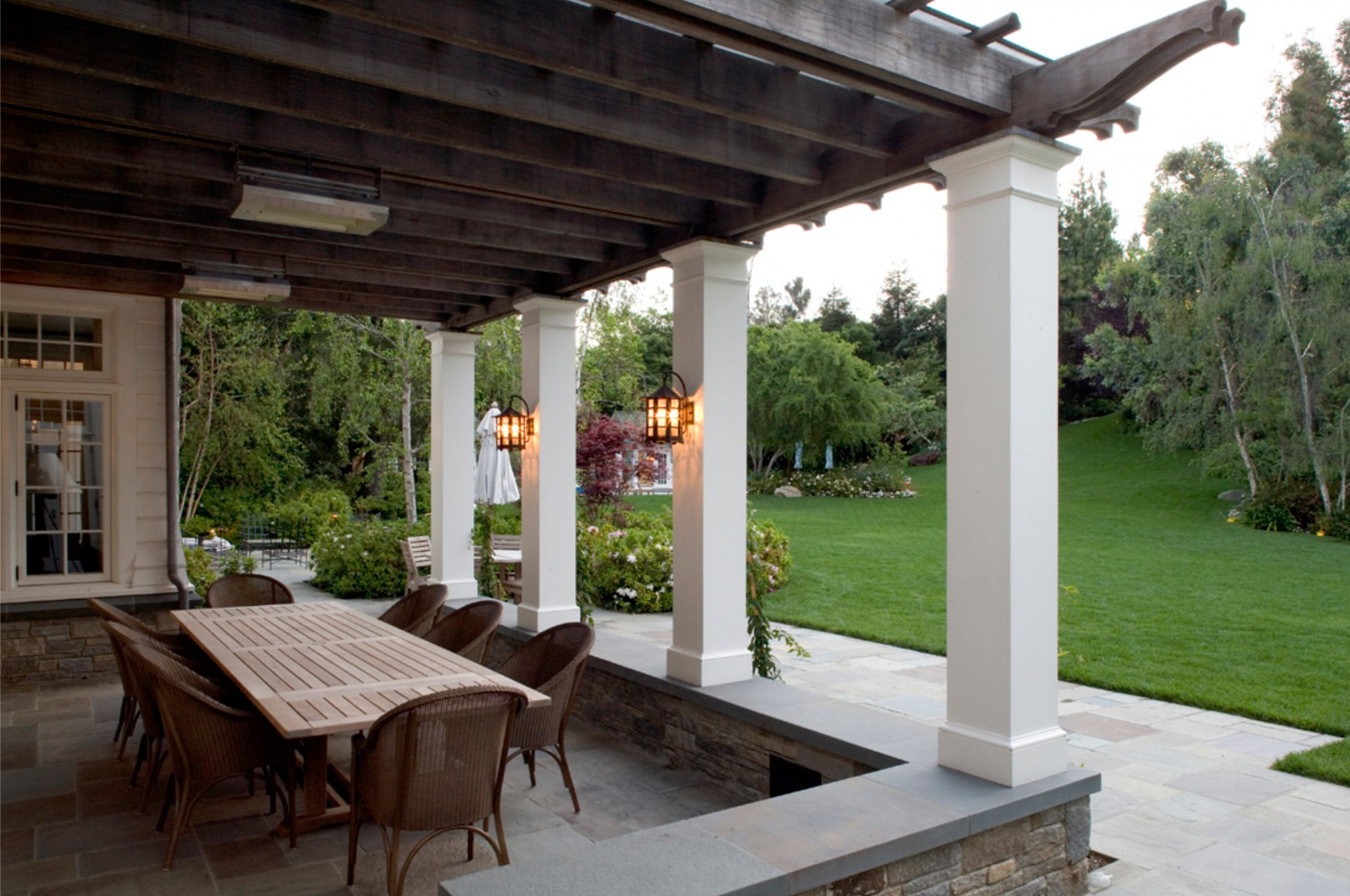 patio designed for living and dining with custom light fixtures