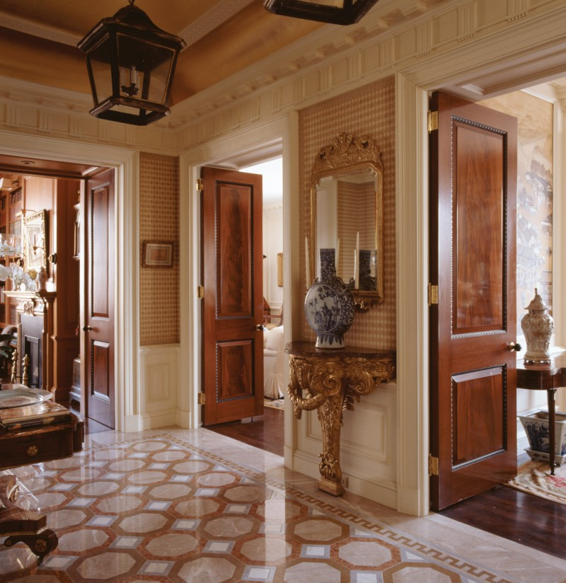marble tile foyer gold gilt ceramic stand. Beautiful polished wood doors charles edwards hardware