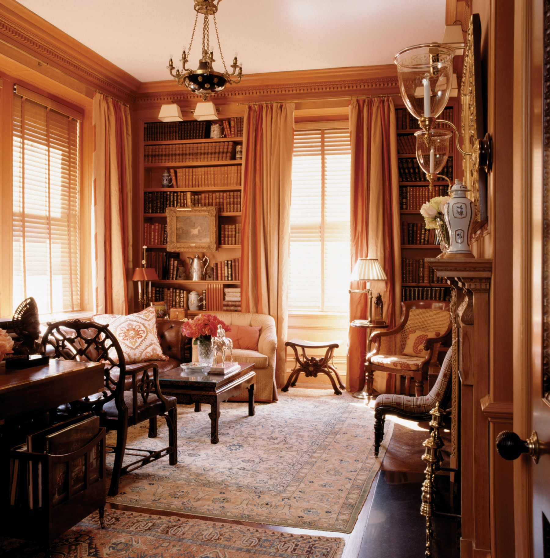 traditional library filled with art and antiques