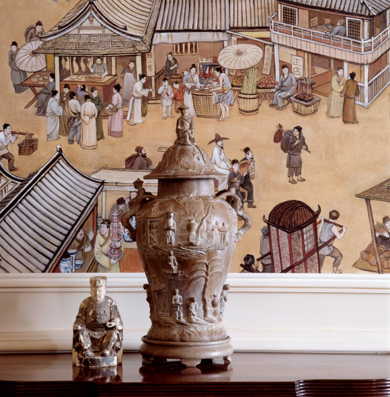 asian art on an antique side buffet table