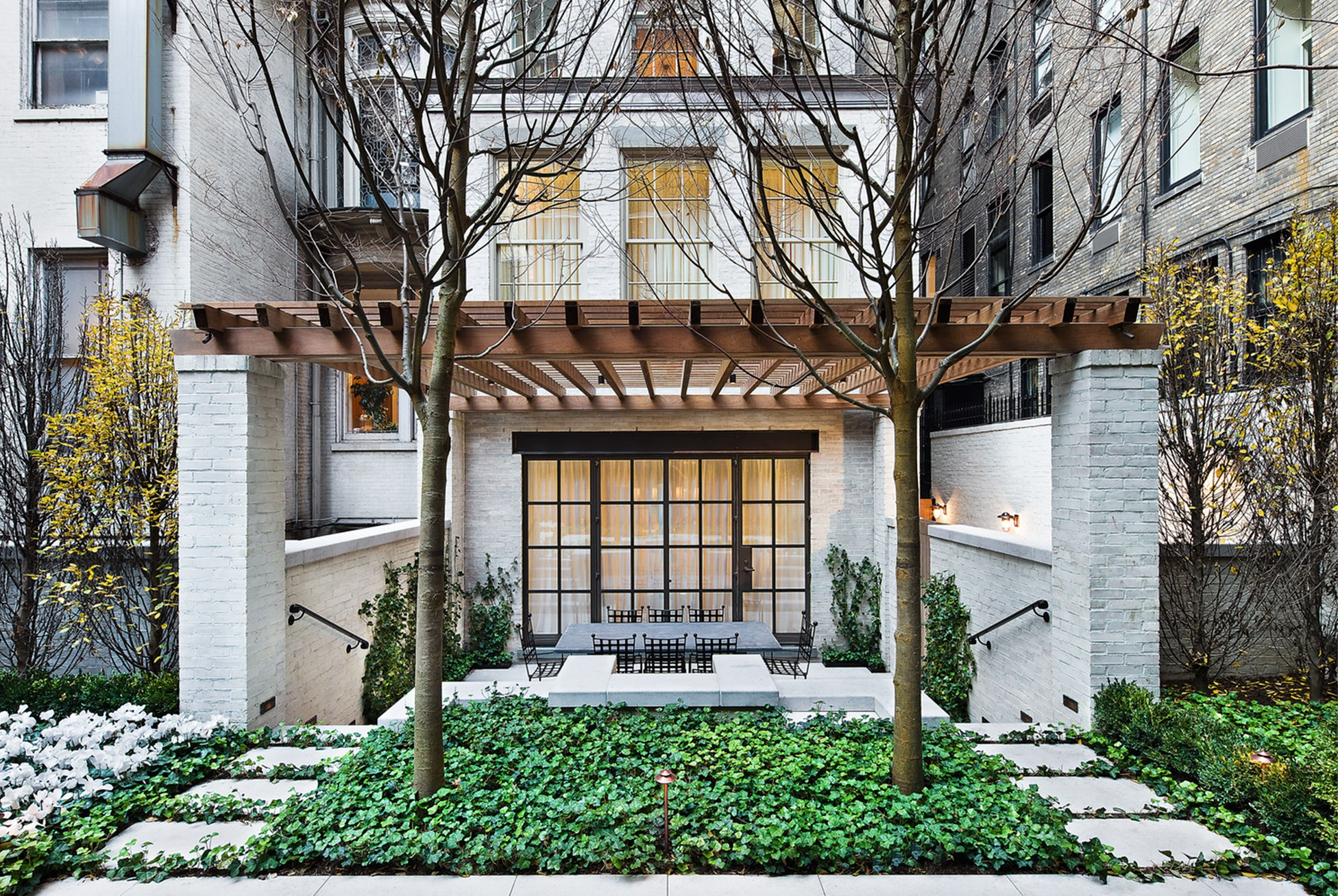 NYC garden design for entertaining. Custom doors and pergola